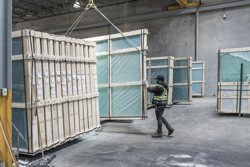 Careful handling of a large sheet of glass