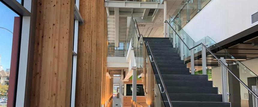 Glass stair railing inside an office